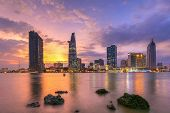 cityscape ( night view ) of Saigon river at downtown ( center ) of ho chi minh city, Vietnam sunset