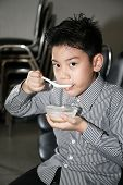 Little Asian Child Drinking Cream Of Thai Dessert