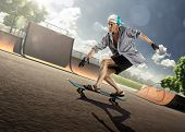 stock photo of skate board  - The old man is skating on skateboard in skate park - JPG
