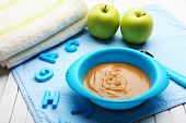 Fresh baby food in bowl with spoon