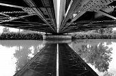 Bridge reflection on the water.