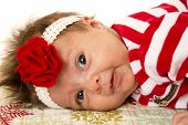 Cute Newborn Girl Laying Down With Flower Headband