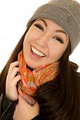 Pretty Asian American Teen Model Smiling Wearing A Beanie And A Scarf