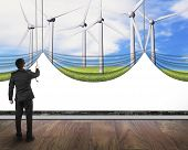 Businessman Pulling Open Wind Turbines Curtain Covered Blank White Background