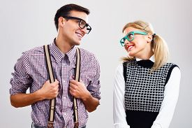 stock photo of shy woman  - Shy nerdy woman and man are flirting - JPG