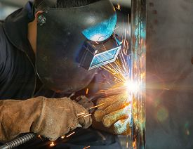 picture of welding  - worker welding construction by MIG welding onsite - JPG