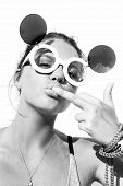 picture of middle finger  - Young blonde girl in sunglasses kissing middle finger - JPG