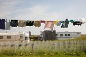 foto of trailer park  - Trailer homes and laundry drying on line in North Rustico - JPG
