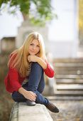 foto of straight jacket  - Young beautiful blonde woman with long straight hair and gray - JPG