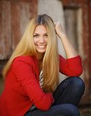 image of straight jacket  - Young beautiful blonde woman with long straight hair and gray - JPG