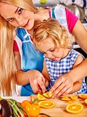 foto of pinafore  - Mother and daughter prepare at kitchen - JPG
