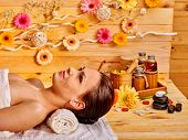 foto of stone-therapy  - Woman getting stone therapy massage in wooden gerbal spa - JPG
