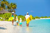 image of children beach  - Happy beautiful family on a beach during summer vacation - JPG
