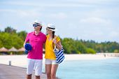pic of jetties  - Couple on a tropical beach jetty at Maldives - JPG