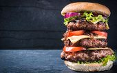 picture of burger  - Triple American burger with cheese and grilled onionsselective focus and blank space - JPG