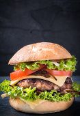 stock photo of beef-burger  - Beef burger with cheese and grilled oniosselective focus and blank space - JPG