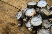 pic of pressure vessel  - Old pressure gauge or damage pressure gauge of oil and gas industry on wooden background - JPG