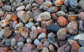 foto of solids  - Colorful stones and boulders on riverbed - JPG