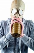 picture of gas mask  - A young man wears a gas mask isolated over a white background - JPG