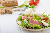 pic of baguette  - Arugula salad with smoked rump sundried tomatoes cashew nuts and mozzarella wholemeal baguette - JPG