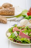 foto of baguette  - Arugula salad with smoked rump sundried tomatoes cashew nuts and mozzarella wholemeal baguette - JPG
