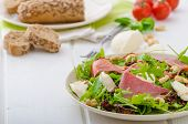 image of baguette  - Arugula salad with smoked rump sundried tomatoes cashew nuts and mozzarella wholemeal baguette - JPG