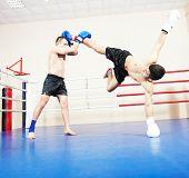 picture of boxing ring  - muai thai sportsman fighting at training boxing ring - JPG