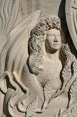 stock photo of funeral home  - lovely carved angel in stone - JPG