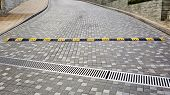 image of bump  - Traffic safety speed bump on an asphalt road - JPG