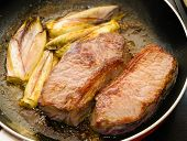 picture of endive  - Cooked beef tenderloins with endives in a pan - JPG
