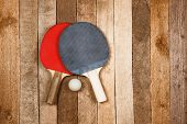 picture of ping pong  - Ping pong paddles and ball on retro wooden background - JPG