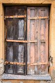 stock photo of abandoned house  - Boarded up window of a abandoned house - JPG