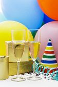 stock photo of flute  - Champagne flutes and balloons isolated on a white background - JPG