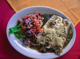 picture of enchiladas  - Mexican meal of chicken enchiladas with salsa verde and fresh tomato salsa - JPG
