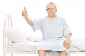 picture of hospital gown  - Mature patient sitting on a hospital bed - JPG
