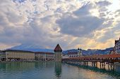 Chapel Bridge in Luzern a landmark destination in Switzerland with beautiful sky poster