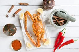 picture of cooked crab  - Top view cooked delicious hot and spicy sauce blue crab and ingredients - JPG