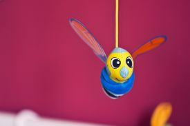 picture of jousting  - Little bee hanging above baby bed - JPG