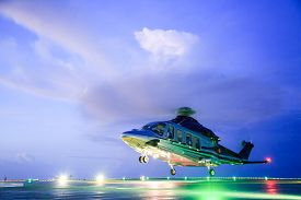 stock photo of helicopters  - helicopter parking landing on offshore platform - JPG