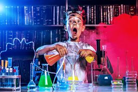 picture of mad scientist  - A boy doing experiments in the laboratory - JPG