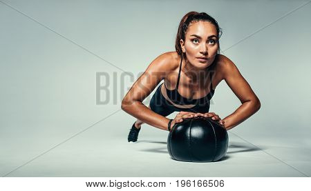 poster of Fit Woman Doing Push Up On Medicine Ball