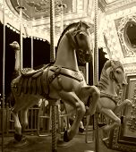 stock photo of merry-go-round  - carousel horse ride in black and white - JPG