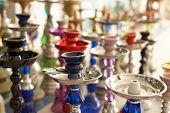 Different hookahs - asian street marketplace. Shallow focus depth