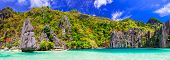 Exotic tropical islands. Unique incredible nature of El Nido, Palawan. Panorama of blue lagoon with  poster