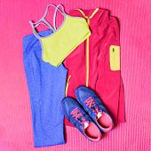 Gym outfit workout clothes on exercise yoga mat. Fitness clothing, running shoes, leggings, sports b poster
