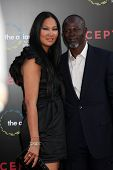 LOS ANGELES - JUL 13:  Kimora Lee Simmons & Djimon Hounsou arrive at the Inception Premiere at Graum