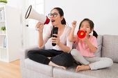 Young Mom And Daughter Through Megaphone poster
