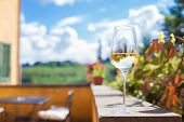 Glass Of Chilled White Wine On A Tuscany Background. Agriturismo Vacation In Italy poster