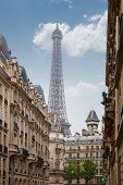 view on the Eiffel Tower in Paris between city buildings, France poster