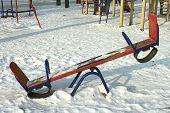 Children's swings against the winter snow